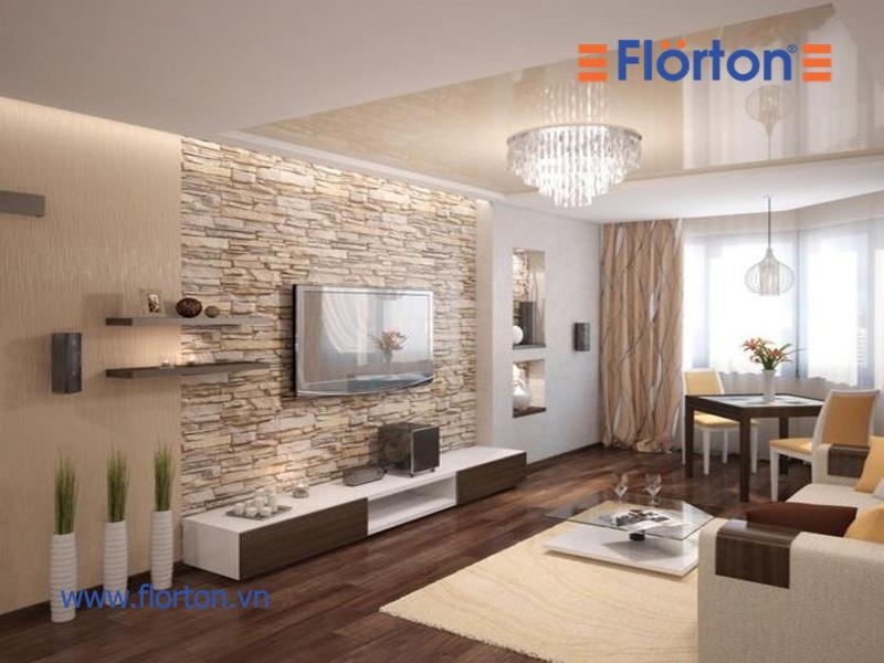 Sử dụng thảm ở phòng khách giúp bảo vệ sàn gỗ tránh được những tác động của nước